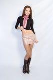 Het meisje in een korte rok Stock Fotografie