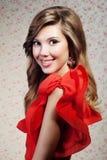 Het meisje in een rode kleding Royalty-vrije Stock Foto