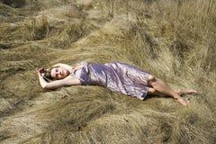 Het meisje in een vloer stock foto