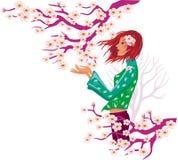 Het meisje en de boom van de lente in bloei. Royalty-vrije Stock Afbeeldingen