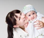 Het Meisje en de Moeder van de baby Royalty-vrije Stock Afbeelding