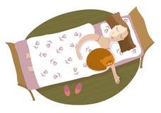 Het meisje en een kattenslaap op een bed Royalty-vrije Stock Afbeelding