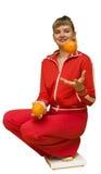 Het meisje en een oranje dieet Stock Foto