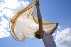 Het meisje en een wind royalty-vrije stock afbeelding