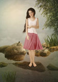 Het meisje en froglet Royalty-vrije Stock Afbeeldingen