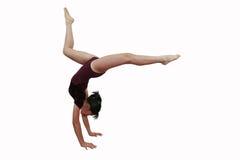 Het meisje in gymnastiek stelt stock afbeelding