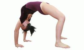 Het meisje in gymnastiek stelt royalty-vrije stock foto