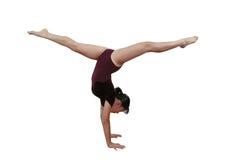 Het meisje in gymnastiek stelt royalty-vrije stock foto's