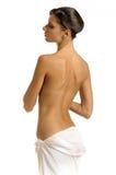 Het meisje in handdoek met naakte rug Royalty-vrije Stock Foto's