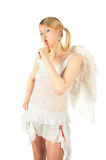 Het meisje in het kostuum van de engel heeft vinger aan lippen gezet Royalty-vrije Stock Foto