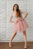 Het meisje in het roze Stock Afbeelding