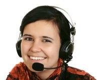 Het meisje in hoofdtelefoons Stock Afbeeldingen