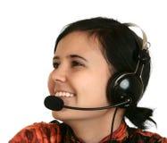 Het meisje in hoofdtelefoons Stock Afbeelding