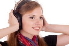 Het meisje in hoofdtelefoons sluit omhoog royalty-vrije stock afbeeldingen