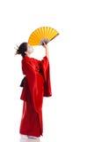 Het meisje in inheems kostuum van Japanse geisha Royalty-vrije Stock Afbeeldingen