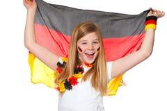 Het meisje juicht voor het Duitse voetbalteam toe Stock Foto