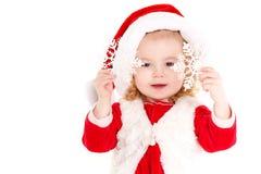 Het meisje kleedde zich als Kerstman Royalty-vrije Stock Foto's
