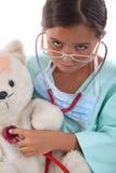Het meisje kleedde zich in verpleegstersuitrusting Stock Foto
