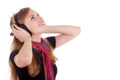 Het meisje krijgt genoegen van muziek Stock Foto