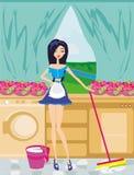 Het meisje maakt de keuken schoon Stock Afbeeldingen