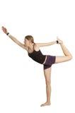 Het meisje maakt gymnastiek- oefening Royalty-vrije Stock Fotografie