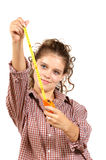 Het meisje maakt reparatie Stock Foto