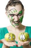Het meisje met appelen Royalty-vrije Stock Afbeelding