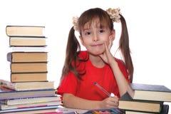 Het meisje met boeken Stock Afbeeldingen