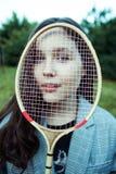 Het meisje met de racket stock foto's