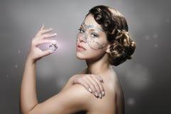 Het meisje met diamant maakt omhoog Stock Foto's