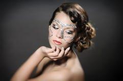 Het meisje met diamant maakt omhoog Stock Afbeeldingen