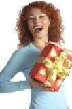 Het meisje met een gift Stock Afbeeldingen