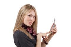 Het meisje met een mobiele telefoon royalty-vrije stock afbeelding