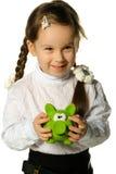 Het meisje met een spaarpot - een varken stock afbeelding