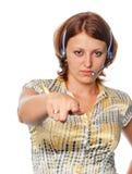 Het meisje met hoofdtelefoon richt een vinger stock afbeelding