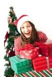 Het meisje met Kerstmis stelt voor stock afbeeldingen
