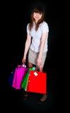 Het meisje met multi-colored document pakketten Royalty-vrije Stock Foto