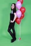 Het meisje met rode ballons Stock Afbeelding