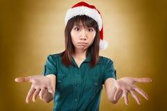 Het meisje met santahoed heeft geen idee Stock Fotografie