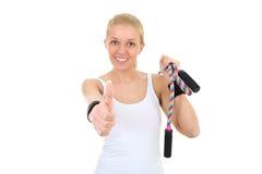 Het meisje met touwtjespringen beduimelt omhoog Royalty-vrije Stock Foto's