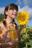 Het meisje met zonnebloem Stock Afbeelding