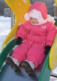 Het meisje op een speelplaats van kinderen royalty-vrije stock afbeeldingen