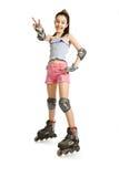 Het meisje op rollen toont een overwinningsteken Stock Foto's
