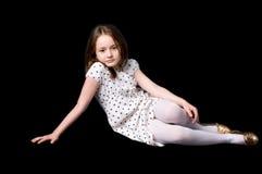 Het meisje op zwarte royalty-vrije stock afbeeldingen