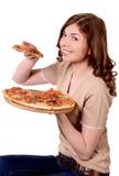 Het meisje probeert en bijt pizza Royalty-vrije Stock Foto's