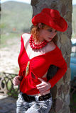 Het meisje in rood Stock Afbeeldingen