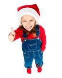 Het meisje in santahoed toont de duim Stock Afbeeldingen