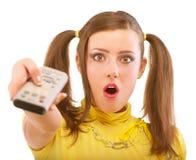 Het meisje schakelt programma over TV stock fotografie