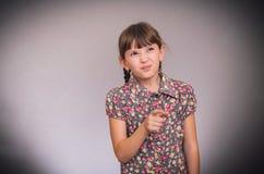 Het meisje schudt vinger Stock Foto