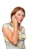 Het meisje spreekt door mobiele telefoon royalty-vrije stock afbeeldingen